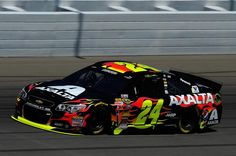 JEFF GORDON WINS THE POLE FOR SECOND WEEK IN A ROW---MICHIGAN SETTING NEW TRACK RECORD. AUGUST 2014