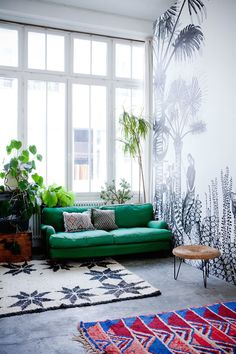 Green sofa, lush planting and incredible jungle wallpaper at home with Bien-Fait Paris | FrenchByDesign