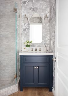 Before & After: A Hollywood Hills Home Gets a Classic Renovation Fornasetti wallpaper by Cole & Son makes a … Blue Bathroom Vanity, Powder Room Vanity, Blue Vanity, Bathroom Vanity Cabinets, Bathroom Wallpaper, White Bathroom, Bathroom Interior, Small Bathroom, Fornasetti Wallpaper