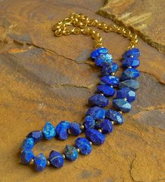 """Chunky faceted blue lapis, gold beads and chain. Approximately 22"""" in length. Perfect for layering or wearing alone. #HandmadeJewelry #jewelrymakingforkids"""