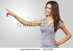 beautiful young woman pointing her finger towards blank space - stock photo