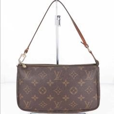 AUTHENTIC LOUIE VUITTION POCHETTE  BAG Good size to carry accessories and cosmetic or use as a Clatch bag.  Have loved this bag for the the many uses. NO RIP OR HOLES. JUST REGULAR WEAR. Size: W7.9 X H 4.7 X D12 in inches. It CM: W 20 X H13 X D 3. PLS NOTE: THIS BAG WILL BE SHIP IN 5 DAYS. Louis Vuitton Bags Shoulder Bags