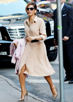 Eva Mendes wearing a belted polka dot shirt dress and nude pumps