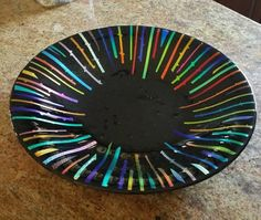 The fused glass bowls are layers of colored glass fused into one solid circle and then slumped or draped in a second kiln firing. The sizes and shapes vary as do the prices. Each bowl has a lead...