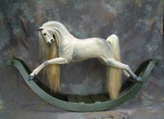 A lively horse with a very unusual tucked in, turned and twisted head, together with an Arab-like tail. This horse gives a feeling of great movement.    Dappled in a natural style on a green bow (which was very popular in the Georgian and Victorian era), he has havana leather tack with a cream fleece and numnah.    Also available in traditional styles of dappling and natural wood finishes.