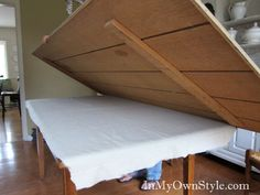 Putting-table-top-extention. How to make a small table seat significantly more by laying on an overlay table top. This is exactly what I envisioned...good to have a visual.