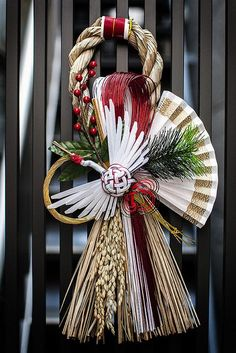 """""""Shimekazari"""" in Asakusa, Tokyo, Japan. Many Japanese decorate the entrances of their homes with Shimekazari during the New Year's season to ward off evil spirits. They are made of Shimenawa, sacred Shinto rope of rice straw, used to indicate the sacred areas where gods descend."""