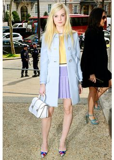 Elle Fanning busts out an ethereally summery look with a leg-baring outfit in a cotton-candy palette that's sweet and stylish. The powder-blue spring coat's clean lines set the tone for the simple yellow top and textured blue miniskirt underneath. A white handbag and bleached-out mane complete the airy weightlessness of the look; then she lays on a big slam of colour with boldly floral heels. We love the vibe – and we're stealing it! What's so great about this look is that you can use…