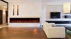 Is an Electric Fireplace Worth the Money? | Angie's List Linear Fireplace, Fireplace Design, Fireplace Mantels, Fireplace Wall, Modern Fireplaces, Fireplace Remodel, Fireplace Inserts, Mantles, Fireplace Ideas