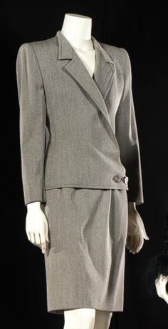VALENTINO  Couture, circa 1990 Carver gray whipcord, jacket notched collar, asymmetric two-button placket on long sleeves, straight skirt.