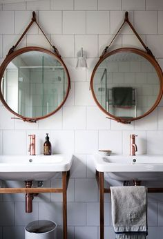 Twin Round Hanging Mirrors With Vintage Sinks