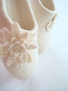 Felted slippers from white natural wool