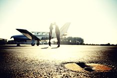Artistic flair with an engagement shoot on an airport runway, complete with an airplane and cute kissing couple!