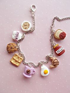 Food charm bracelet jewelry created from polymer clay. With delicious sweets. The full lenght of it is 21 cm and it is ajustable, you can switch to one link to another. Each charm is between 1 and 2 cm long. The charms are completely made out of polymer clay, without using molds of forms. ❀