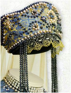 Kokoshnik - The kokoshnik is a commonly used name for a variety of traditional Russian headdresses worn by women and girls to accompany the sarafan, primarily worn in the northern regions of Russia in the 16th to 19th centuries.