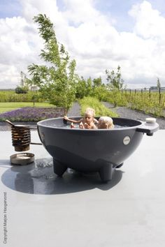 holy moly. dutchtub, wood fired hot tub. 3,200 euros (so in other words, in my dreams)