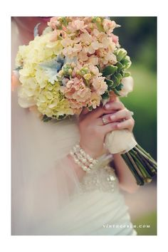 corals creams greens and greys- hydrangeas, dusty miller, stock, berries, roses- wedding bouquet