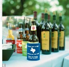 Personalized beer koozies for 'useful' wedding favors :)