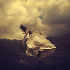 'Dust in the Wind' Brooke Shaden's images that shows off the beauty of movement in fabric.