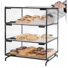 "3 Level Pastry Case Item: PC300-13 (Black) PC300-39 (Platinum). Three-level Strata Style Pastry Display Case offers a convenient and hygienic way of serving bagels, muffins, croissants etc. Welded, 3/8"" solid steel bar frame & acrylic case can safely support accessories or our Bagel Bin!"