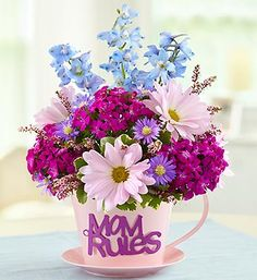Send Mother's Day flowers in a mug with 1800Flowers' Mom's Tea Party™ bouquet! Mom can reuse the mug for coffee and tea to remind them of you for years to come! Starting at just $34.99!