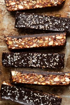 Healthy date bars are nuts and seeds bound together by homemade date paste, baked in the oven and topped with chocolate. Gluten-free, vegan and have no added sugar. Vegan Desserts, Dessert Recipes, Vegan Recipes, Healthier Desserts, Vegan Foods, Snack Recipes, Lazy Cat Kitchen, Date Bars, Healthy Treats