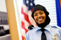 St. Paul Community Officer Kadra Mohamed smiles after receiving her badge from St. Paul Police Chief Tom Smith on Saturday. The police depar...