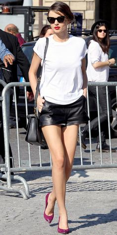 First time I've ever wanted leather shorts! Love the black & white outfit paired with red lips and bright pumps. So glamorous with the cat's eye sunglasses, too.