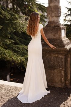 Turn heads in this simply elegant cap-sleeved wedding gown with an open lace back and fitted skirt from Mila Bridal. Made from French crepe, this beauty will allow you to dance comfortably all night long! #weddingdress #lacedress #weddinggown #simpleweddingdress