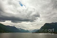 Mountains along the Romsdalsfjorden near Andalsnes under a cloudy sky, Norway