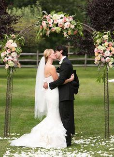 floral wedding arbor featuring Juliet garden roses
