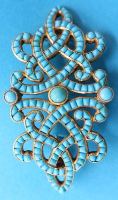 An antique turquoise brooch, 19th century. Converted from a hair comb surmount, the brooch calibré-set with sugarloaf and cabochon turquoises. 5.4 x 2.9 cm. #antique #brooch