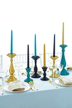 Statement table display - spread out an assortment of candlesticks in various colors and sizes