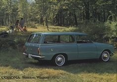 1965 Toyota Corona Station Wagon.  I saw one in a cute shade of orange I wanted to buy.  I guess I have to wait until I can figure out how to grow money on trees to buy all the cars I want! :)