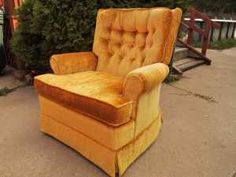 1970's style chair.  We had these and they were so comfortable.  They rocked and swiveled.