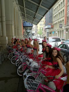 Girls wearing the Hello Kitty x Chubby Bunny bow and riding Hello Kitty bicycles cruised around New York City, promoting the Big Pink Bow event at Sephora! How cute are they?