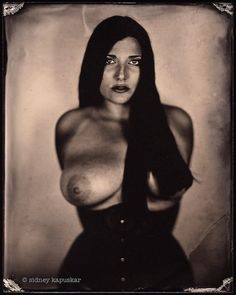Wet Plate on ruby glass by Sidney Kapuskar. Private collection.