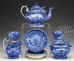 "1) 19th century. A dark blue Staffordshire teapot with an impressed mark. 2) Circa 19th century. Sugar bowl with impressed Wood mark. 3) 19th century. Creamer with impressed Wood mark. 4-9) 19th century. Two handle less cups, three small saucers and one larger saucer. The two cups with ""Washington Tomb"" decorated interior, most marked with various marks. SIZE: 1) 7"" h. 2) 5-1/2"" h. 3) 6"" h. 4-9) Cups are 3-3/4"" dia, sm saucers 6"" dia, lg saucer 6-3/4"" dia. PROVENANCE: From a Maine ..."