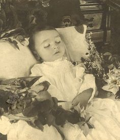 Post mortem photo, seems to be quite odd these days, but in olden times they would quire often take photos of their children when they died, so they could remember them by,