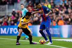 The FC Barcelona player Neymar da Silva from Brasil defensed by The Malaga CF player Roberto Rosales Venezuela during the La Liga match between FC...