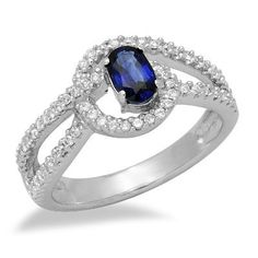 This amazing 18k white gold ring features a lovely 0.60ct oval shape sapphire in a 4 prong setting embraced by 2 rows of brilliant round cut diamonds. The color of the diamonds are G/H and the clarity is SI2/SI3.Different ring sizes may be available. Please inquire for details. $821.00