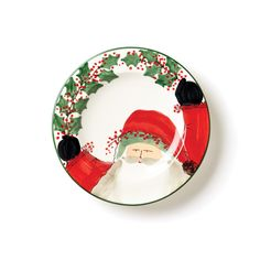 Adorn your home this holiday season with the handpainted Old St. Nick Rimmed Round Wall Plate for a festive Italian touch.