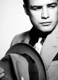 Marlon Brando.  Publicity still from Guys and Dolls, a definite must-see movie. Brando steals the show but Frank Sinatra is great too.