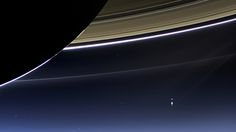 This rare image taken on July 19, 2013, by NASA's Cassini spacecraft has shows Saturn's rings and our planet Earth and its moon in the same frame. At the time, Cassini was 2013 from a distance of about 898.414 million miles (1.445858 billion kilometers) from Earth. It is only one footprint in a mosaic of 33 footprints covering the entire Saturn ring system (including Saturn itself) taken by Cassini's wide-angle camera.