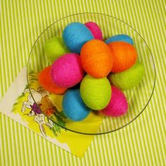 Get the brightest colors by wrapping eggs in colorful yarn, trim, ribbon, or rickrack.