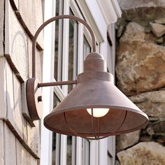 """From the shore to the mountains, this popular outdoor light is a winner. With arched arm, attractive protective bulb grill, and stacked chimney top, the decorative details abound! IDA Dark Sky compliant. Aluminum with stainless steel . Available in Weathered Bronze, Olde Bronze, Brushed Nickel, or Black. 4.75"""" backplate. Wet Location Rated.(14.5""""Hx10.25Wx11.5D)150 watts max, medium base socket."""