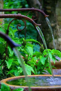 Garden Spouts; gutters empty to rain barrels