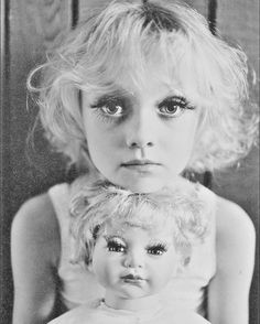 dakota fanning - I would not normally like it because of the eyelashes (think Toddlers and tiaras) but the juxtaposition with the doll makes it an interesting statement