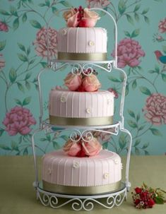 shabby chic 3 separate tier wedding cake!  This could be very nice with a good cake stand!