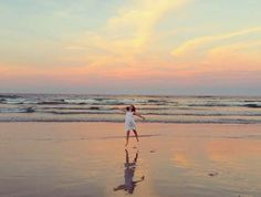 A young girl plays on the beach in an exquisite moment before sundown. - Cyndi Monaghan